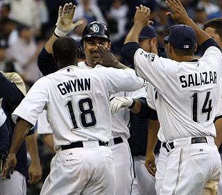 Adrian Gonzalez (center) earns high praise after his second game-winning home run. (AP)