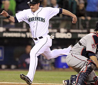 Ryan Langerhans jumps on his horse and motors home from second on Ichiro's hit in the 10th. (AP)