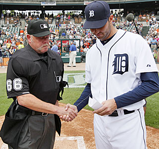 Jim Joyce, the home-plate ump for the series finale, accepts the lineup card from Armando Galarraga.  (AP)