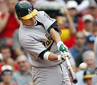 The A's bats come alive against the Red Sox to hit four homers including two by catcher Kurt Suzuki. (AP)