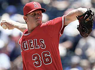 In a battle of aces, Jered Weaver throws seven strong innings to get the better of Zack Greinke. (AP)