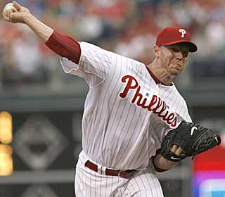 Unlike his last start, Roy Halladay has to work out of trouble but still manages to get the job done. (AP)