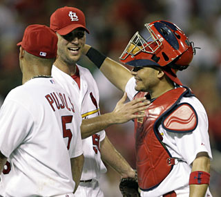 Adam Wainwright improves to 8-3 after notching his first career shutout.  (AP)