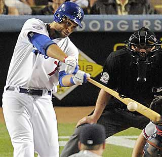 A 4-all tie is broken by James Loney, who produces a solid RBI single in the seventh for the Dodgers. (AP)