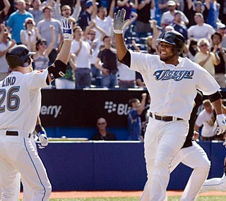 Edwin Encarnacion comes home on Aaron Hill's single to send the Blue Jays to an exciting home victory.  (AP)