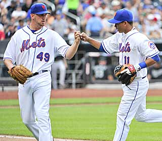 Jonathon Niese (left) allows six hits over seven innings to get his first win at Citi Field in nine tries. (AP)