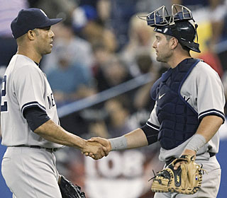 Mariano Rivera is greeted by Francisco Cervelli after Rivera locks up his 13th save.  (AP)