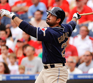 San Diego's Adrian Gonzalez shows off his power swing as the Padres prevail in extra innings.  (US Presswire)