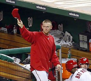 Stephen Strasburg waves to a sell-out crowd following his dynamic debut on the Nationals' mound.  (US Presswire)