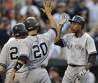 Curtis Granderson gets all the cheers at home plate after his grand slam in the third inning. (AP)