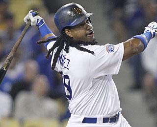 Manny Ramirez hits a ground-rule double to drive in the only run the Dodgers need in this game (AP)