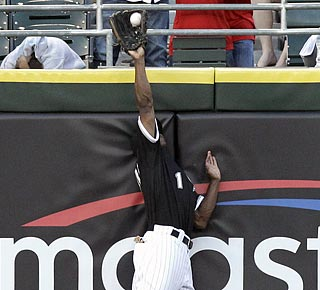 Juan Pierre leaps to take away an extra-base hit from Detroit's Brennan Boesch in the fourth inning.  (AP)