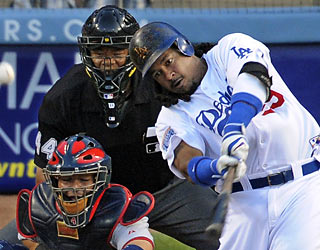 Manny Ramirez gets the Dodgers on the board in the first inning with his fifth home run of the season.  (AP)