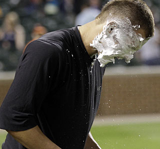 Teammates make sure Jake Arrieta gets a proper pie in the face after winning his major league debut. (AP)