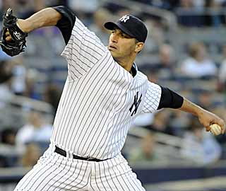 Andy Pettitte joins Whitey Ford and Red Ruffing as the only other Yankees to earn 200 wins in pinstripes. (AP)