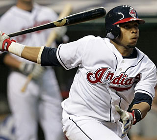 Carlos Santana doesn't get a hit in his debut, but he does get to throw out a baserunner.  (AP)