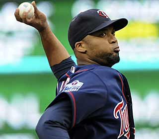 Francisco Liriano strikes out a season-high 11 batters as he outduels the Braves' Tim Hudson. (AP)
