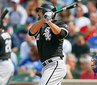 Paul Konerko drives in both runs for the White Sox, one in the first inning and the other in the seventh. (AP)