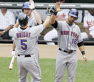 It's celebration time at home plate after David Wright hits his 12th homer of the season. (AP)