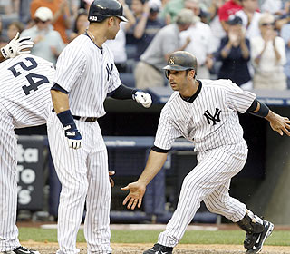 The welcome wagon is out for Jorge Posada after he hits a second grand slam in as many days. (AP)