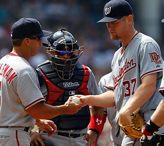 Jim Riggleman relieves Stephen Strasburg in the sixth after the rookie walks two batters.  (Getty Images)
