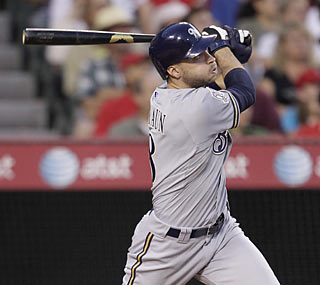 Ryan Braun follows through on his grand slam, which gives Milwaukee a 5-2 lead in the third inning.  (AP)