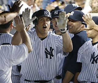 Mark Teixeira is one of three Yankees to take it out of the ballpark off ace Roy Halladay. (AP)