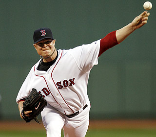Jon Lester scatters four hits over seven innings to earn his eighth straight victory. (AP)