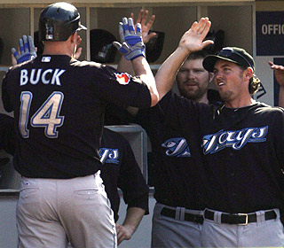 John Buck gets praise after his third HR of the series for Toronto, which has 103 dingers to lead the majors. (AP)