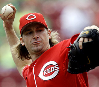 Bronson Arroyo walks six but makes up for the free passes with a HR and helps turn three double plays. (AP)