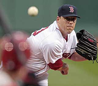 John Lackey labors over 112 pitches but becomes the third Boston pitcher to reach eight wins. (AP)