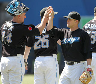 Aaron Hill get props after his 10th homer of the season gives the Blue Jays enough of a lead. (AP)