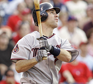 Joe Mauer provides a timely two-run blast, which ties the game in the ninth inning. (AP)