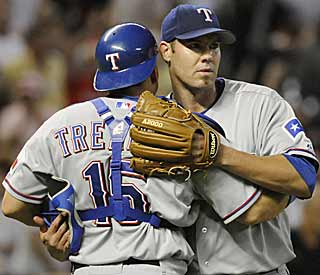 Batterymate Matt Treanor congratulates Colby Lewis after he tosses his first career complete game. (AP)