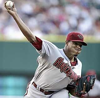 Edwin Jackson pitches strong against his former team to help Arizona get its first road win since May 17. (AP)