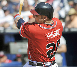 Eric Hinske's eighth-inning double breaks a tie and helps pad Atlanta's lead in the NL East. (AP)