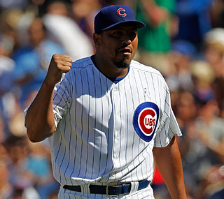Carlos Zambrano has a good afternoon, earning the win on the mound and two hits at the plate.  (Getty Images)