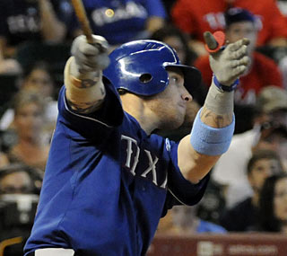 Josh Hamilton matches a career high with five hits and extends his hitting streak to 16 games.  (AP)