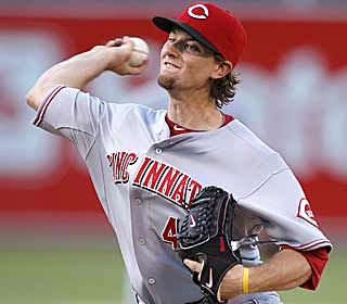 Although he gets a no-decision, Mike Leake keeps the Reds in the game by giving up only one run. (AP)