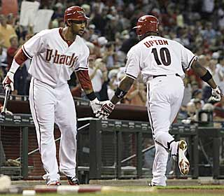 Justin Upton deserves some praise as he goes yard twice in the D-Backs' rout of the Yanks.  (AP)