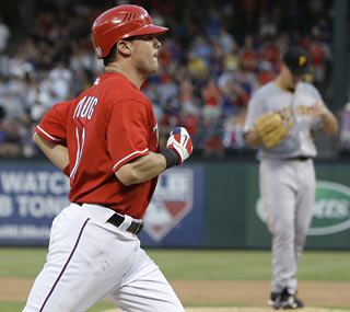 Rangers career hits leader Michael Young chips in with a solo shot in the fourth inning, his ninth of the season.  (AP)