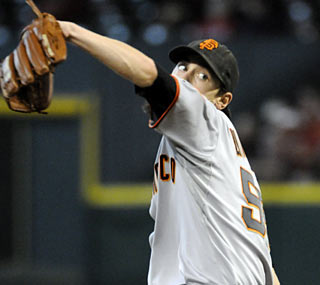 Tim Lincecum gives up one run in eight innings and improves to 5-0 in his career against the Astros.  (AP)