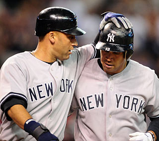 Alex Rodriguez (right) sends one out of the park for the 592nd home run of his career.  (US Presswire)