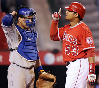 Bobby Abreu celebrates in front of Russell Martin after hitting a game-tying three-run shot.  (AP)