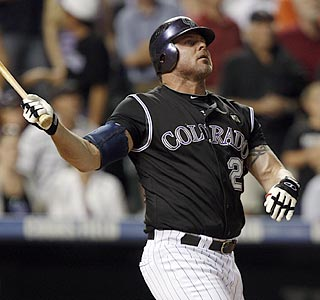 Jason Giambi watches his 412th career home run leave the yard and send the Rockies to victory.  (AP)