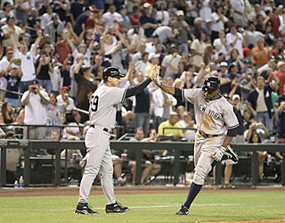 Part of the large contingent of Yankees fans in Phoenix salutes Curtis Granderson's big hit.  (Getty Images)