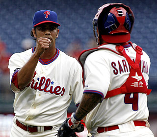 Reliever Nelson Figueroa and catcher Dane Sardinha celebrate the win in which Philly belts 15 hits. (AP)