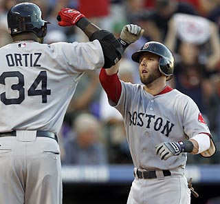 Lil' Dustin Pedroia accomplishes something Big Papi has never done -- three home runs in one game.  (AP)
