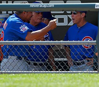 Volatile Carlos Zambrano (left) is apparently upset with teammate Derrek Lee over his fielding.
