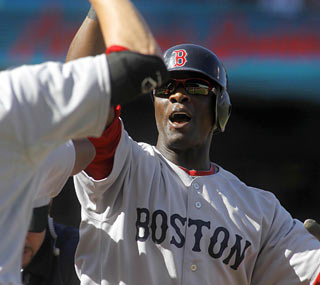 Mike Cameron puts Boston up for good with his three-run blast in the second inning.  (US Presswire)